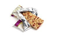 Fruit and cereal healthy snack bar in wrapper on white background