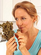 Girl Smelling Oregano