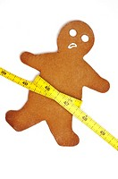 Gingerbread man with tape measure around waist