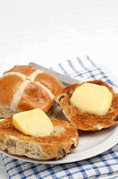 Hot cross buns with butter