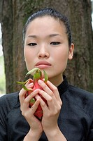 Young woman holding dragon fruit