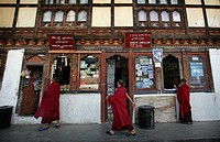 Young Buddhist monks shopping, Paro, Bhutan
