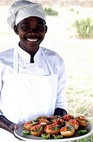 Cook with salmon and cream cheese rolls, Beho Beho Safari Lodge, Selous Game Reserve, Tanzania