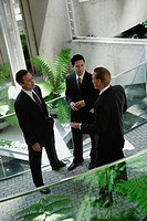 Businessmen standing in building having a discussion