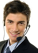 Portrait of a businessman wearing a headset and smiling (thumbnail)