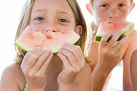 Kids with watermelon slices