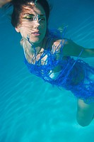 Woman swimming underwater