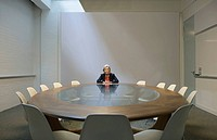 Woman seated in boardroom alone (thumbnail)