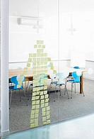 Post-Its stuck on glass wall in the shape of a human
