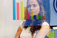 Young woman seen through graph