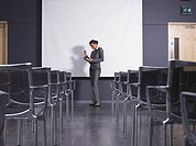 Woman practicing speech in empty presentation room