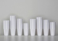 A line of piled up plastic cups