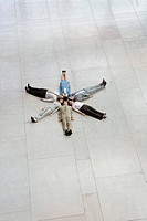 Businesspeople laying in circle