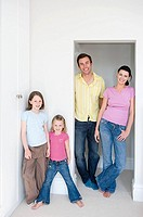 Family standing in a doorway