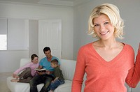 Woman in living room with family