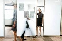 Businesswoman writing on wall