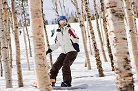 Person snowboarding in woods