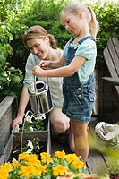 A mother and daughter and gardening
