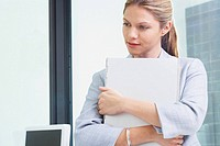 Young Business woman in office with file