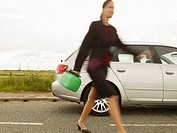 Businesswoman Walking with Fuel Can Blurred Motion