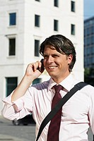 Happy businessman on cell phone