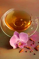 Tea with chili peper and a orchid blossom
