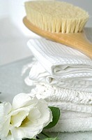 Piqu&#233; towels and a massage brush decorated with lisianthus flowers