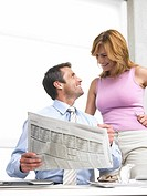 Business woman and man are reading the newspaper