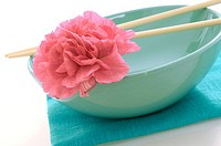 Asian bowl with chopsticks and blossom