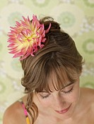 Woman having a chrysanthemum blossom in her hair