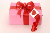 Gift with a red ribbon and a red heart