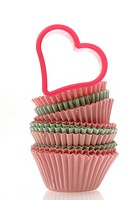 Muffin paper cups and a hearthshape cookie cutter