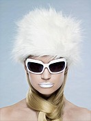 Woman wearing sunglasses and fur hat