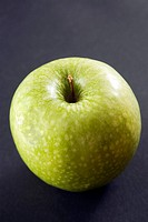 Granny Smith apple, black background