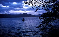 Man in boat in lake (thumbnail)