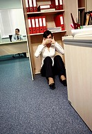 Office worker on the floor covering her mouth (thumbnail)