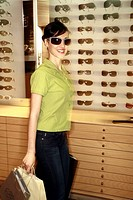 Woman shopping in sunglasses store (thumbnail)
