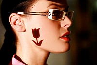 Woman wearing glasses with tulip shape on her face