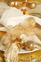Golden place setting with a tassel