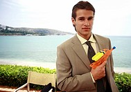 Businessman with plastic water gun