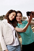 Two women photographing themselves