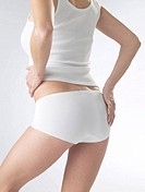 Woman wearing white underwear, cut of waist and backside
