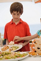 Boy being served by girl at buffet