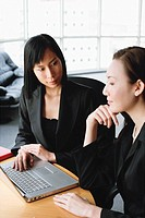 Businesswomen in front of laptop