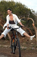 Cycling woman with legs outstretched