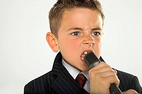 Close-up of a boy singing into a microphone