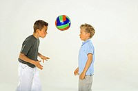 Side profile of two boys arguing each other