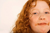 Portrait of a girl eating a chocolate