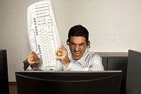 Businessman smashing a keyboard