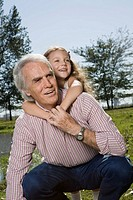 Grandfather and Granddaughter in park (thumbnail)